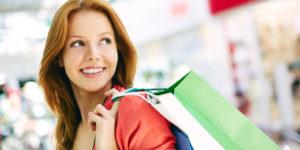 Vender mais - mulher com sacola de compras.